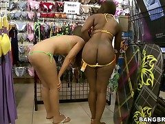 Ebony and fair-haired shot at large bikinis in a