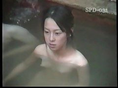 Young naked Asians in the public bathtub are sexy