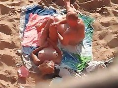Beautiful blond on her back for beach sex