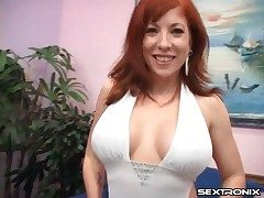 Milf redhead with an astounding set of udders inhales cock